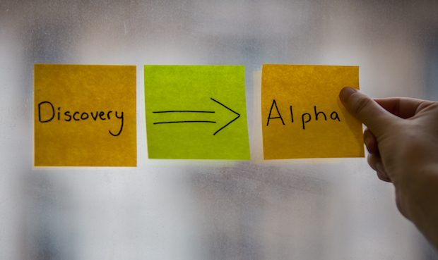 The words discovery and alpha on sticky notes